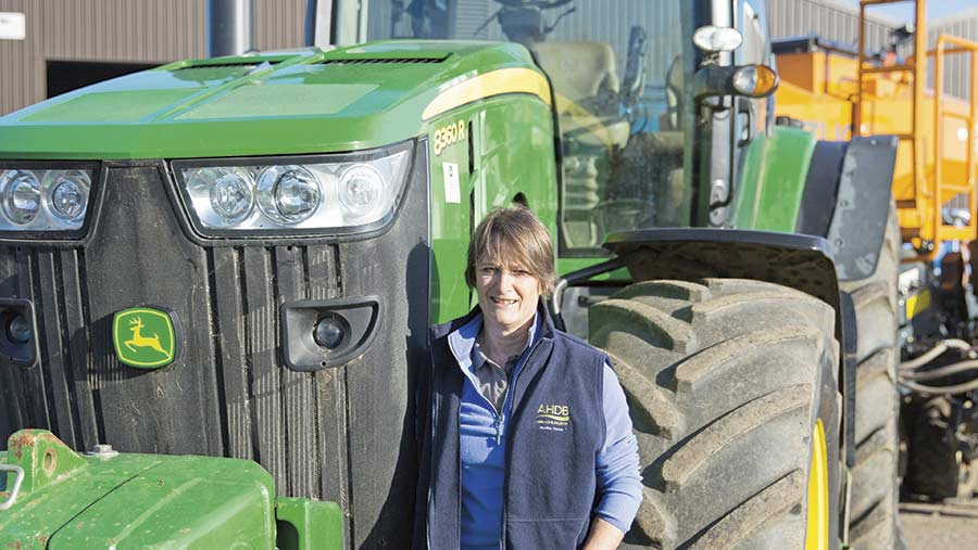 Christy Willett next to a tractor