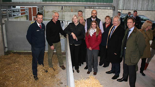 Theresa May with farmers from the farmer-led crime initiative.