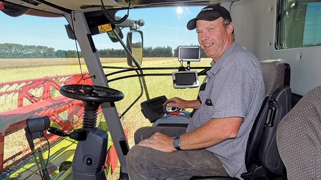 Chris Dennison in his tractor cab