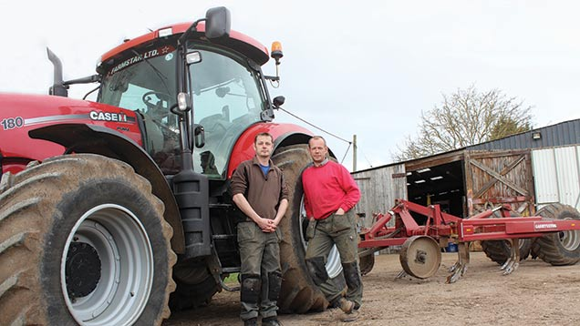 Rob (left) and Dave Gash with their Case Puma 180 and stubble cultivator.