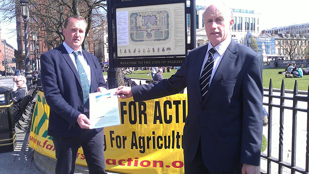William Taylor FFA UK NI co-ordinator (right) and FFA Steering Committee Member Sean McAuley launch the People's Prosperity Manifesto in front of Belfast City Hall.