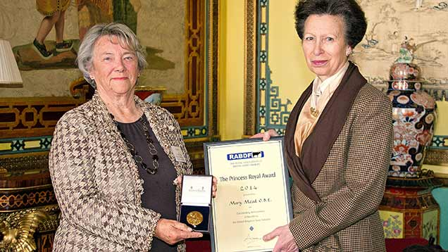 Mary Mead accepting her award from Princess Anne