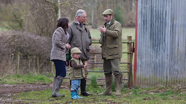 Sam and Emily Stables, new tenants at Kings Pitt Farm, Herefordshire, explain their plans to the Duke of Cornwall.