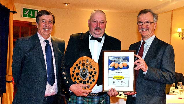 Producer retailer category winner Brian Blyth (centre); Mike Youney, ForFarmers (left) and Professor Nick Sparks, SRUC.