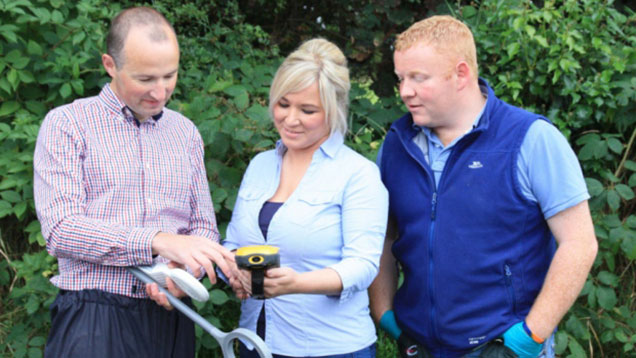 Michelle O'Neill (centre) visits a badger trap and vaccinate or remove trial site in 2014.