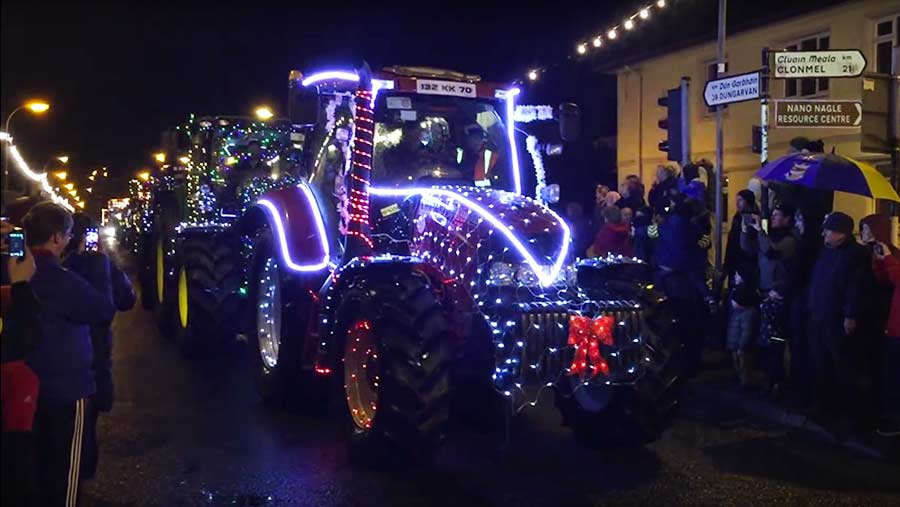 Video Tractors Decorated In Christmas Lights Parade Through Town Farmers Weekly