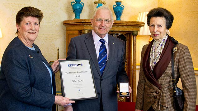 John Alvis, with his wife Pauline, receiving his award from Princess Anne.