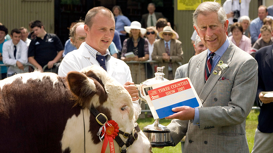 Prince Charles inspects a winning bull at the Royal Three Counties Show © Tim Rooke/REX/Shutterstock