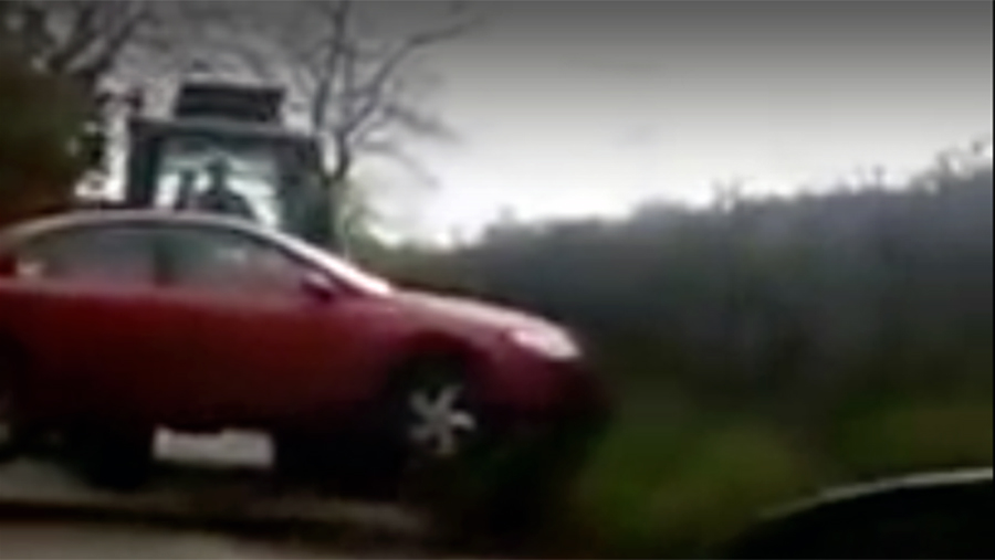 Tractor carrying car in Somerset