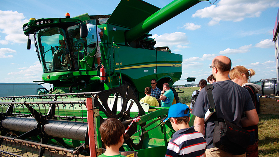 Open Farm Sunday visitors look at combine
