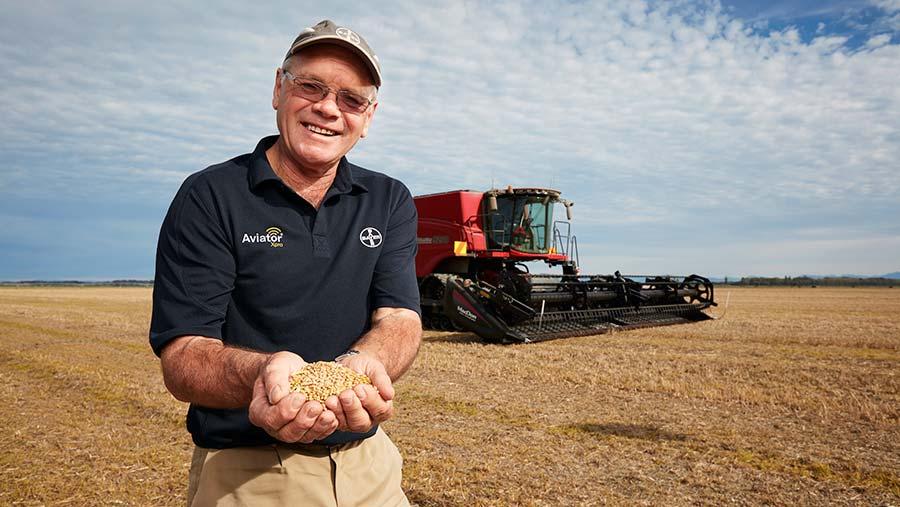 Eric Watson with a handful of his high-yielding wheat grain