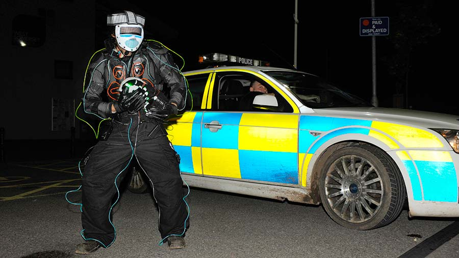 The Somerset badger patrol, with one member dressed as a robot © London News Pictures/REX/Shutterstock