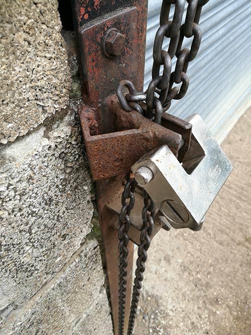 Heavy duty padlock on a farm shed door