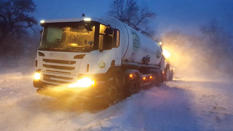 Arla milk tanker drives through the snow. © John Roberts