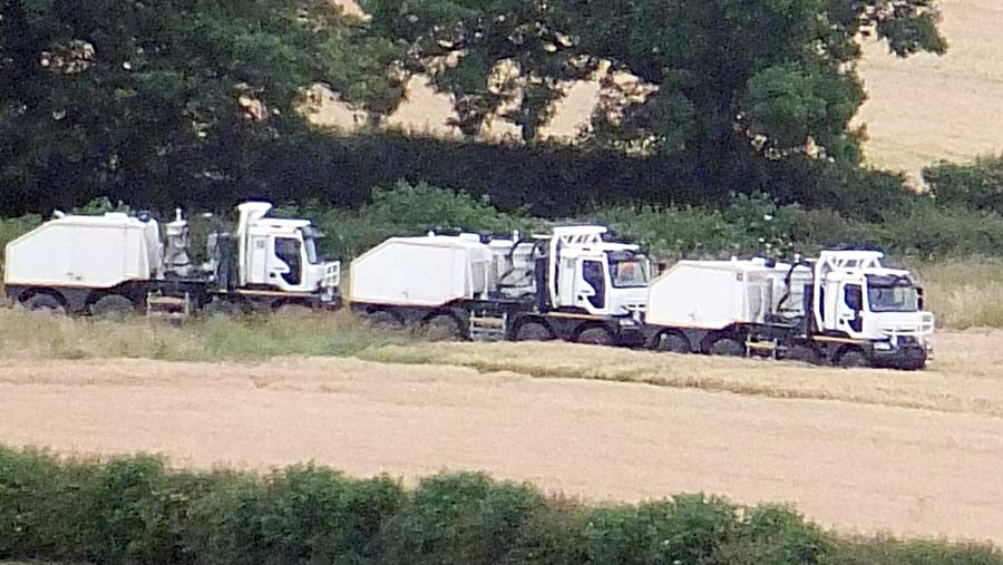 Truck-mounted seismic vibrators enter farmland in preparation for 3D underground mapping © Howzat Photography
