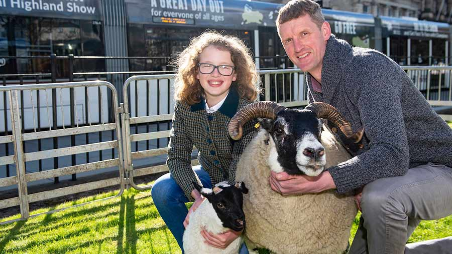 Breeder Malcolm Coubrough and his daughter Emily (11) with Emily the Champion Scottish Black Face Sheep © Lenny Warren
