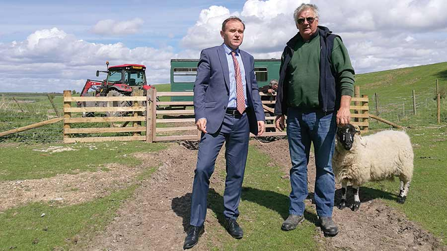 George Eustice with livestock farmer
