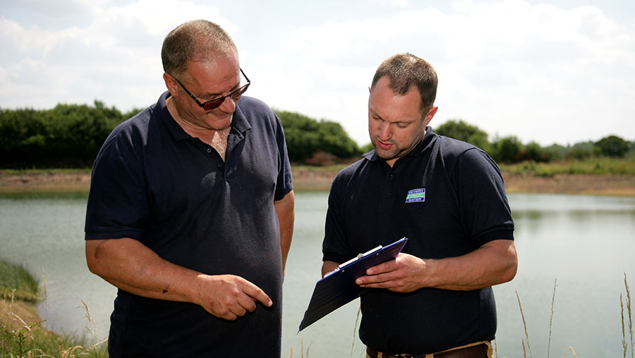 Severn Trent agricultural adviser Ben Young (right) with farmer Doug McCowan, who received more than £1,000 from this scheme last year