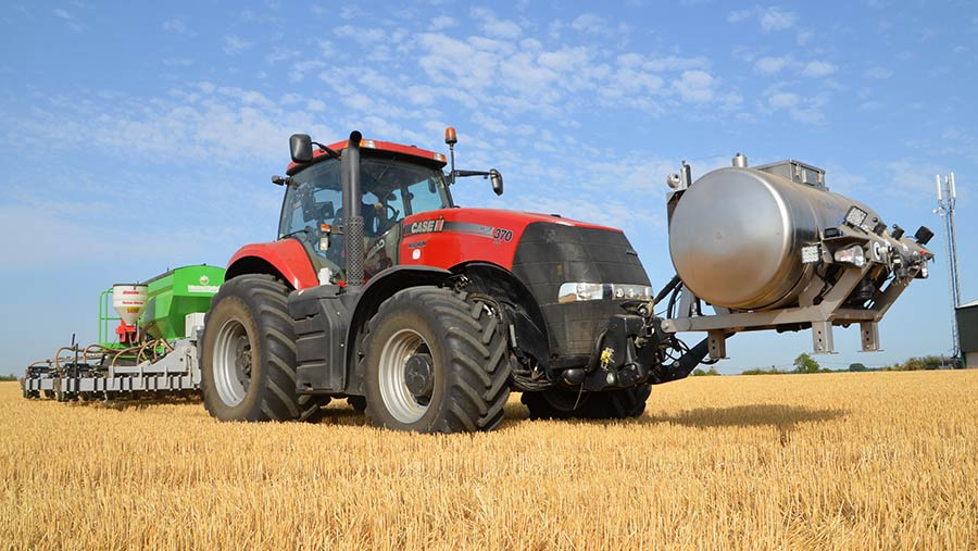 Case tractor with front-mounted stainless steel tank