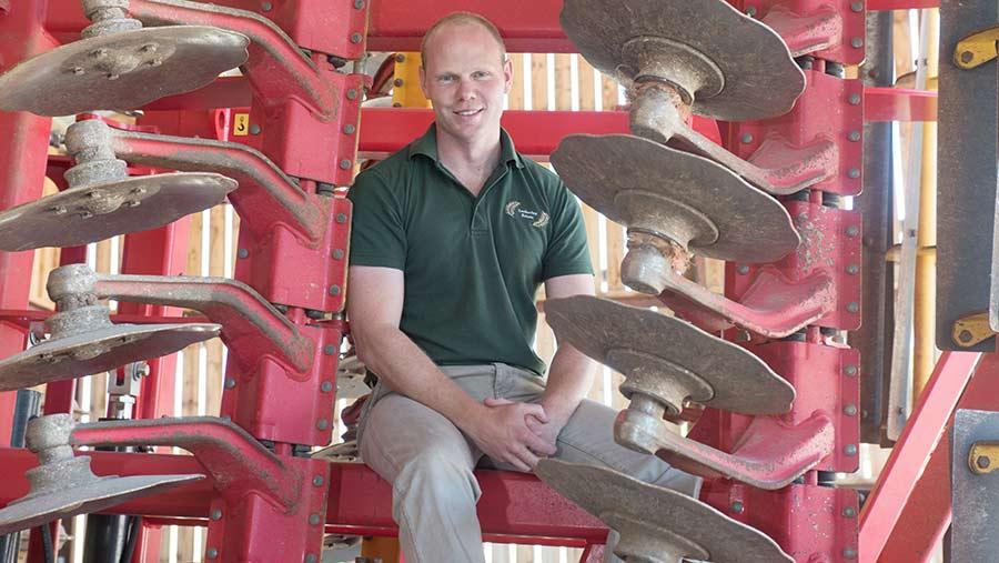 Craig Livingstone on a farm machine