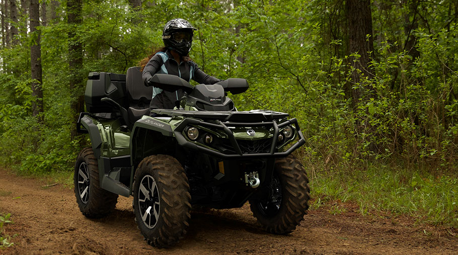A rider drives a Can-Am Outlander Max Limited