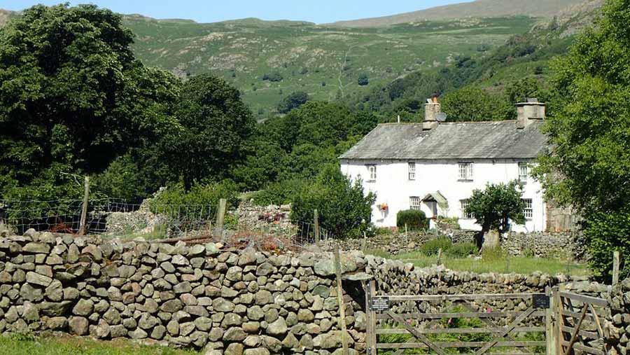 Farmhouse behind a dry stone wall