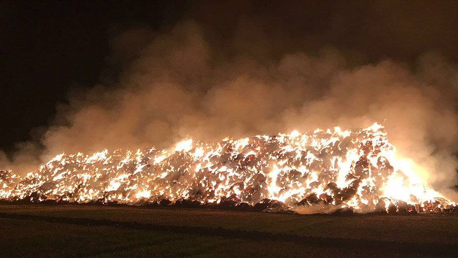 Straw stack burns during the night