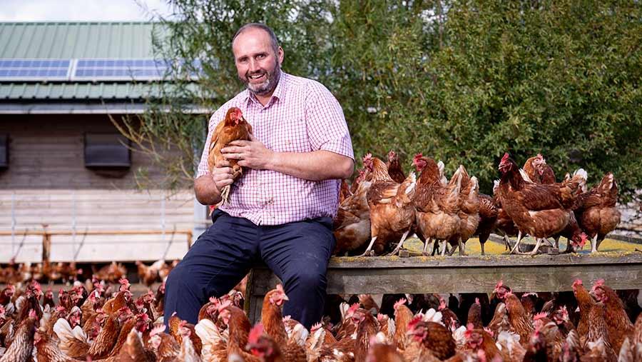 Phillip Crawley holding a chicken