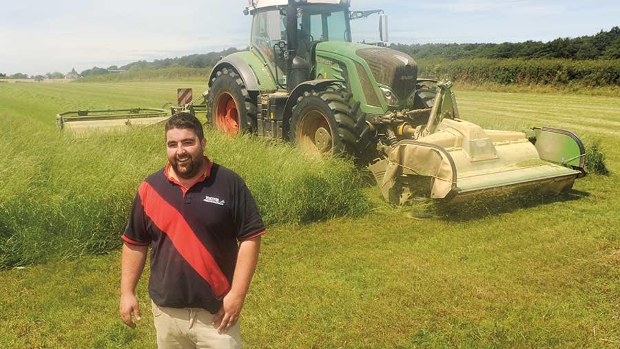 Robert Chapman stands in a field