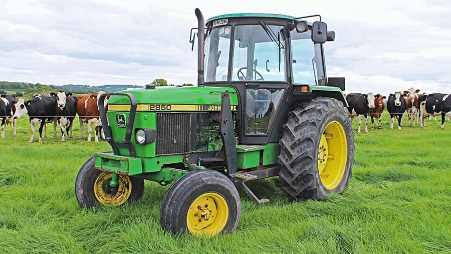 John Deere 2850 in field with cows