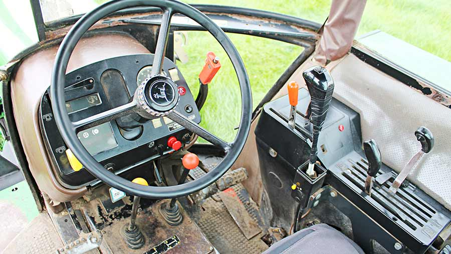 Inside the cab of the John Deere 2850 tractor