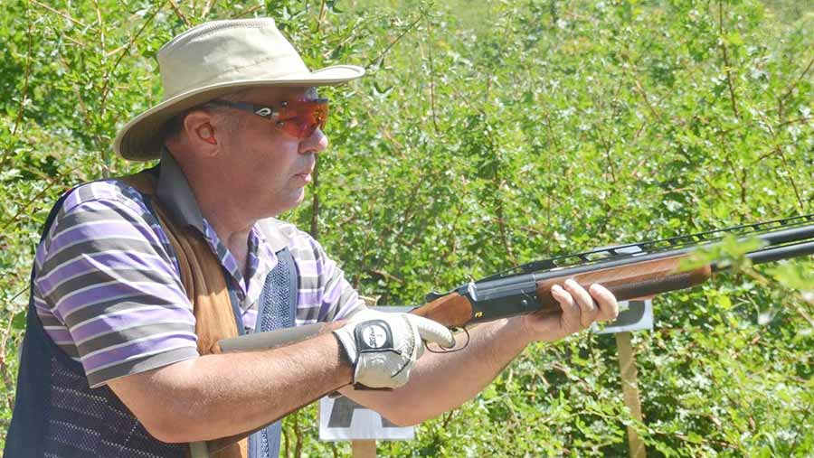 Farmer and clay shooter Phil Rowbottom holds his shotgun