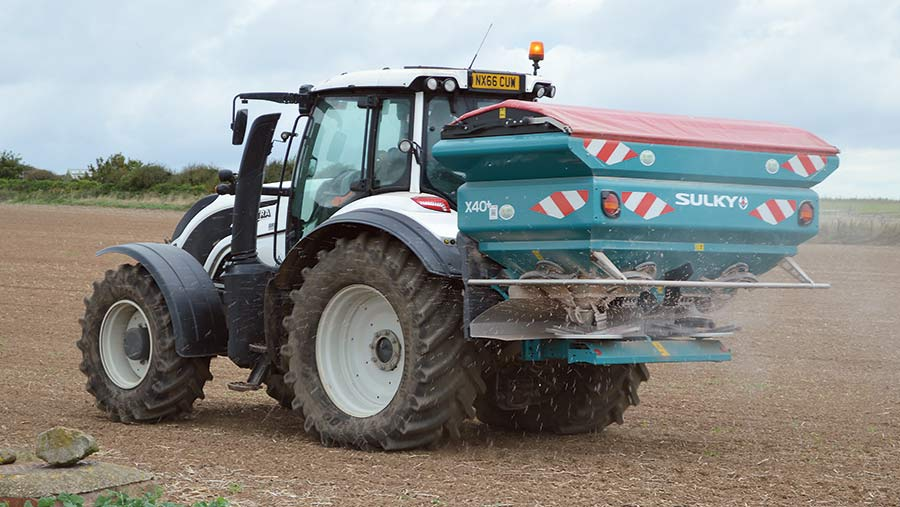Tractor spreading polyhalite fertiliser