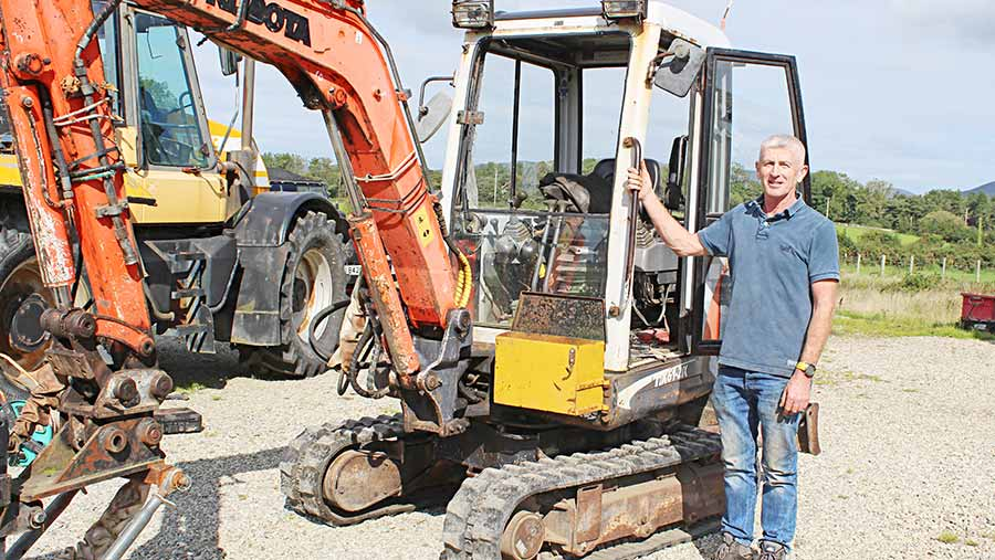 Inventor Cyril Patterson with his Kubota mini-digger