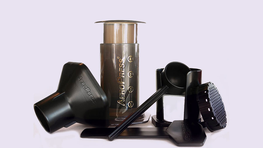 The AeroPress single-cup coffee maker with various accessories