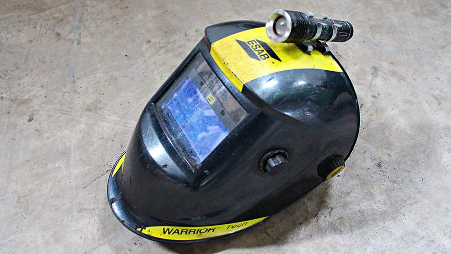 An ordinary LED torch clips on to the top of a welding mask
