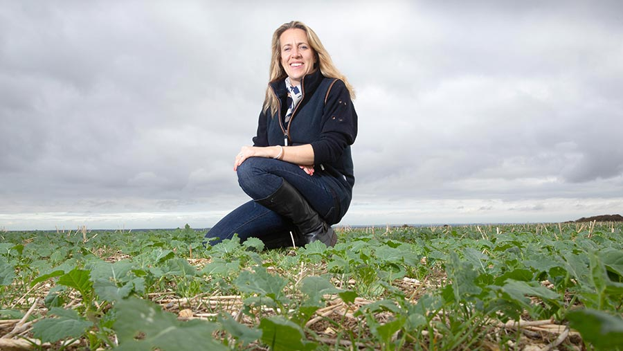 Whizz Middleton crouching in field