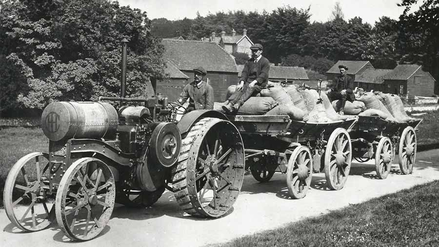 An early 1920s picture showing an International Harvester Titan tractor with the steel lugs removed from the driving wheels for transport work