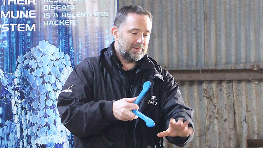 Vet Karl Collins with a pelvic measuring device