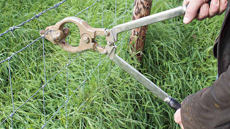 Fence wire crimper built from an old castrator