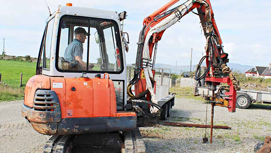 Post knocker attached to the Kubota mini digger