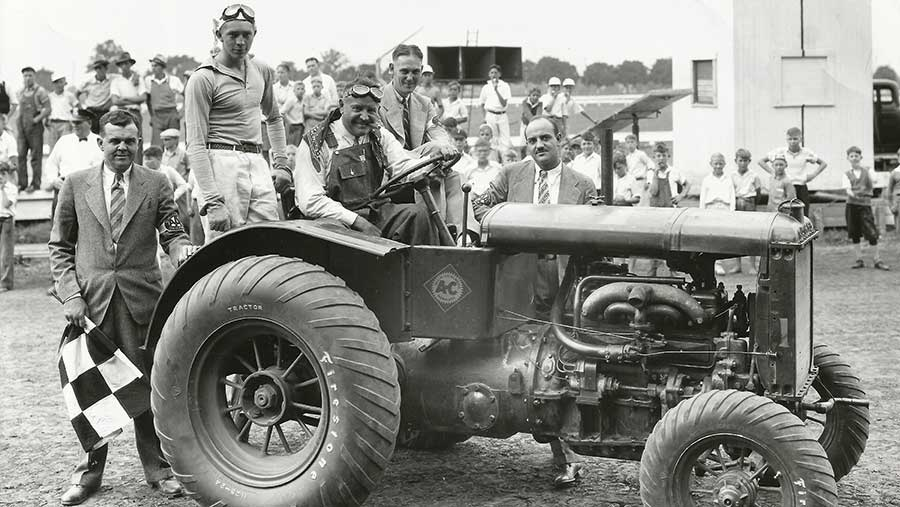 Barney Oldfield, one of America's most famous motor racing drivers in the early 1930s, posing at the wheel of his race-winning Model U tractor