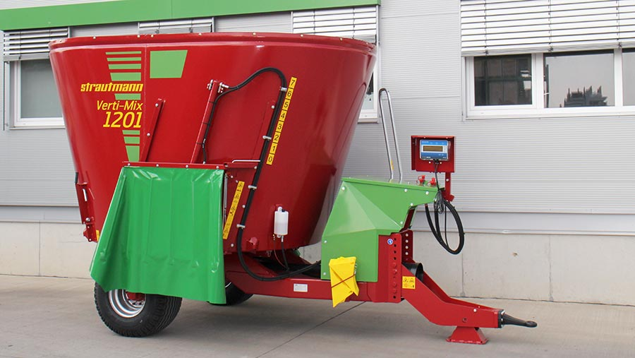 A red feed mixer wagon