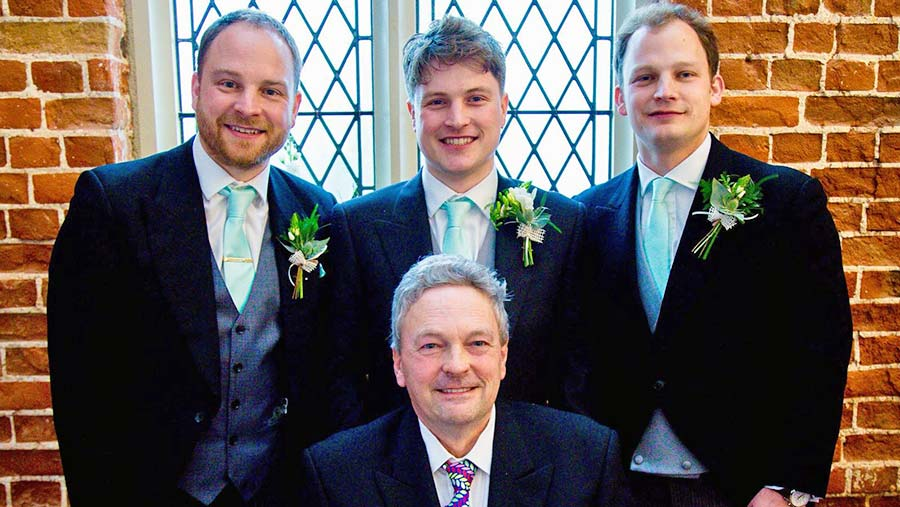 Dad with his three boys at my brother George's (centre) wedding. My oldest brother Tim is on the left.