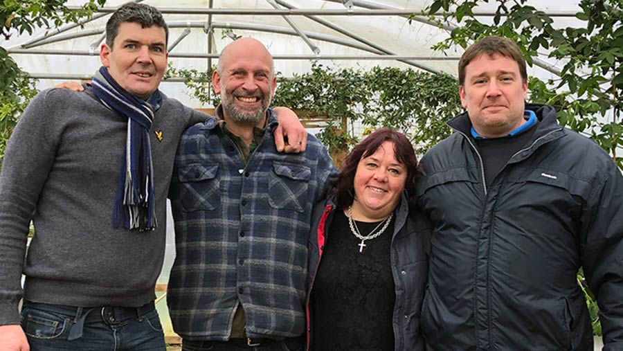 Rob Addicott (second from left) with Tina Hubball and two Dairy House residents © Oli Hill/RBI