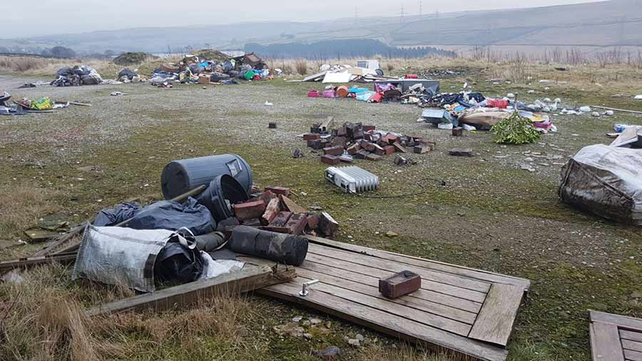 Piles of rubbish spread over an area of flat ground