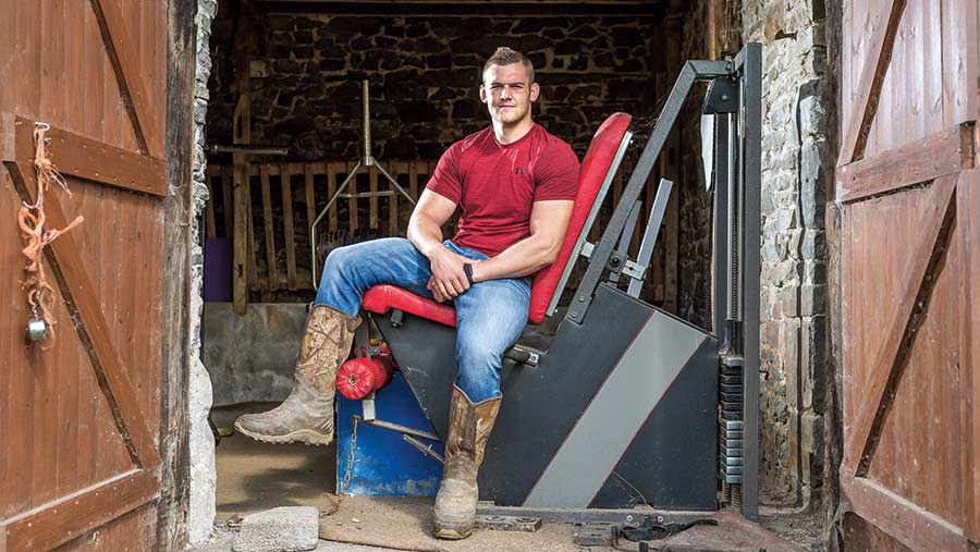 Rugby player Dan Lydiate sits in his barn