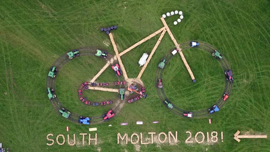 Aerial view of huge bicycle formed of farm machinery