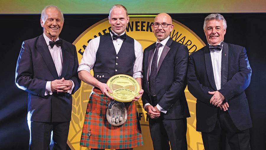 Craig Livingstone receives his award