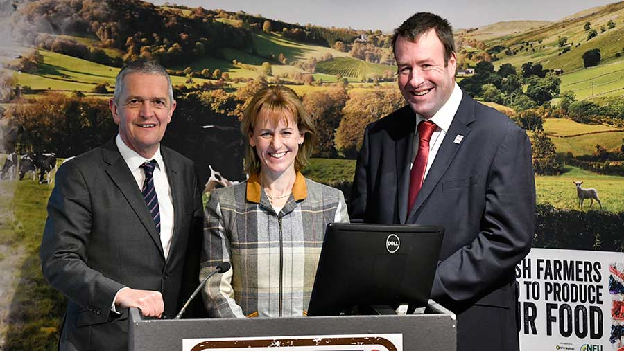 Guy Smith, Minette Batters and Stuart Roberts stand behind a podium